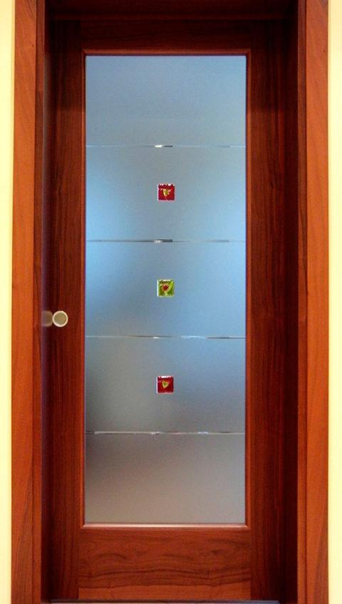 Porta Decorata con Formelle